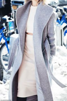 A pale skirt set and an oversized grey coat. Perfect color blocking.