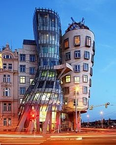 Dancing House in Prague by Frank Gehry in 1996.  Shows Shape, colour  and use of differnt materials.