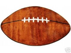 "Football Shaped Kids Rug - 28"" x 45"" Football http://www.amazon.com/dp/B000EIO554/ref=cm_sw_r_pi_dp_zw7wub0RJZYGH"