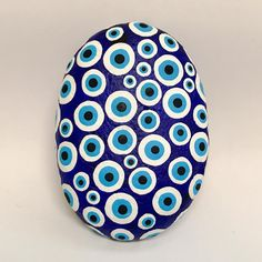 """Got to give a shout-out to @lindseybridgesart for posting a gorgeous dotted rock that reminded me I'd been meaning to do an """"evil eye"""" rock like this for a while! #paintedrocks #rockart #rockpainting #stoneart #stonepainting #paintedstones #art #painting #louisville #502rocks #decoartrocks #igers #evileye #evil #eye #blue #dots"""