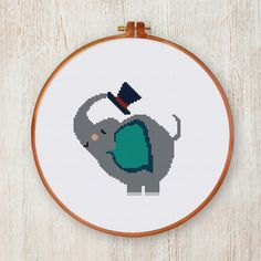 If you look for a cute animal nursery design, start with this happy little baby elephant cross stitch pattern. A simple pattern yet lovely to look at. PATTERN SPECIFICATIONS: Stitches: full cross stitch Colors: DMC stranded cotton Required Colors: 8 Stitch size: 66 x 92 SUGGESTION: Fabric: 14 count Aida Strands: 2 Designed area: 4.71 x 6.57 inches or 12 x 16.7 cm This PDF pattern contains: - Cover - Floss Palette - Color Symbol Chart - Black and White Symbol Chart SHIPPING: INSTANT DOWNL...