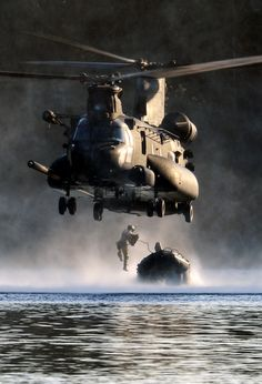 Airman from the 22nd Special Tactics Squadron's Red Team jumps out of an MH-47 Chinook helicopter July 14, 2014, during helocast alternate insertion and extraction training with Soldiers from the 160th Special Operations Aviation Regiment at American Lake on Joint Base Lewis-McChord, Washington. The Airmen from the STS conducted 10 daytime helocast iterations and eight nighttime helocast iterations over a two-day span. (U.S. Air Force photo/Staff Sgt. Russ Jackson)