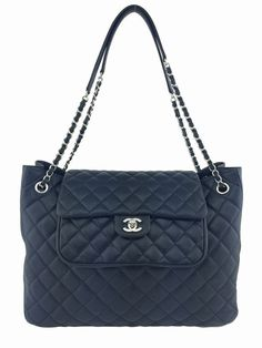 Chanel Black Quilted Caviar Leather Large Shopping Tote - This is a Chanel Black Quilted Caviar Leather Large Shopping Tote from the 2015 Cruise Collection. This classic bag features silvertone hardware, including a double chain link shoulder strap threaded with black leather and four protective metal feet. The classic flap with signature CC turn lock closure opens to an ultra spacious interior finely lined in a smooth black textile fabric with zip and flat open pockets. This is the perfect…