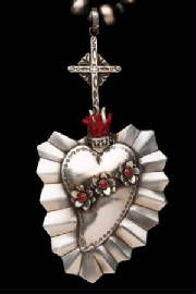 Sterling Silver and coral sacred heart necklace by Native Santa Fe Southwestern Style Jewelry artist Gregory Segura...LOVE this !!!!