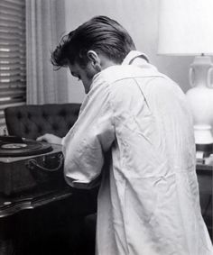 Famous people hanging out with their vinyl - Elvis Presley.