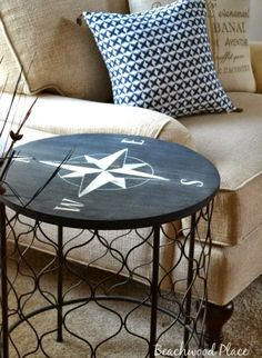 Nautical compass rose painted on a round side table. Easy diy update for an old table