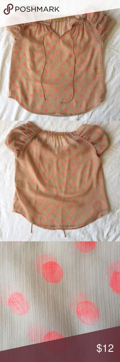 .Princess Vera Wang. Sheer tan polka dot blouse Sheer tan polka blouse with orange polka dots. Cute gather detail at neckline and on cap sleeves. Blouse ties in front. Like new condition. Casual and breezy with shorts on a warm day. Princess Vera Wang Tops Blouses