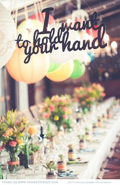 Long table, colourful decor & sign | Photography: Blackframe Photography