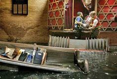 Removing Torah scrolls from New Orleans' flooded Beth Israel Synagogue following Hurricane Katrina.