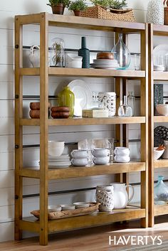 Organize your book collection or use our West Pointe bookcase as an extension of your pantry. With antique brass hardware, four hardwood shelves and a rustic oak finish, this piece boasts subtle, vintage appeal. Fill it with books or adorn it with photos and decorative accessories or dishes for a modern take on a classic shelf piece.