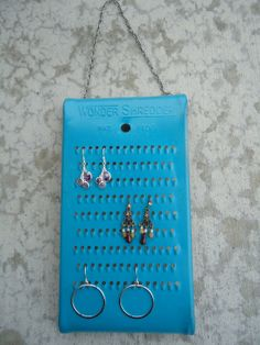 I thought about using a regular cheese grater, but we don't have a spare one of those. lol Hanging Earring Holder Display - Cheese Grater Jewelry Holder - Cheese grater repurposed