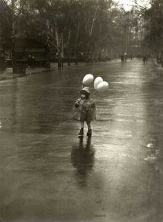 Tibor Honty: Child with balloons in the rain, Slovakia.