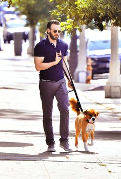 Chris walking down the street with a precious accessory.