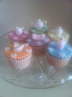 Afternoon Tea Cupcakes. Decorated with a miniature edible tea set, handmade by myself. So gorgeous X