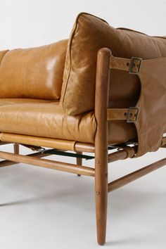 Patrizia Sofa, Lager  DETAILS  Modeled after a 1970s vintage piece, this comfy couch is perched atop a solid elm frame and covered in top-grain leather that buckles at the side like a valise.