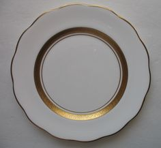 "Four 4 pieces - Royal Albert - White Plates with Gold Band & Scalloped Rim. Three (3) are in Excellent, pre-owned condition with barely a sign of use/storage. One (1) dinner plate does have a 1"" long scratch on the rim - near the edge (see pic), but otherwise appears unused. 