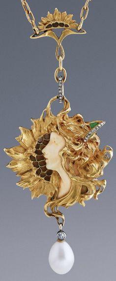 An Art Nouveau Sunflower Pendant, by Léopold Gautrait, Paris, circa 1900. 18k gold, ivory, plique-à-jour enamel, diamonds and pearl. Pendant length: 8.5cm. #Gautrait #ArtNouveau #pendant