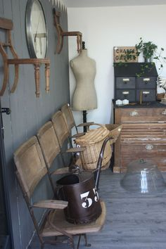 Love the chairs on the wall... But I don't think my home will ever be this rustic... :(