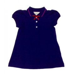 f31602dc8b442a Baby girls Gucci stretch cotton piquet navy polo dress has a red grosgrain  bow at the neck with three branded buttons.