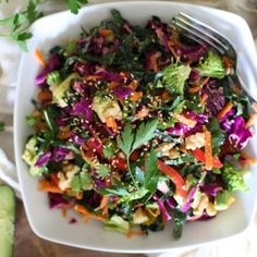 The Ultimate Detox Salad with kale, cabbage, carrots, broccoli, walnuts, avocado, and lemon-mustard dressing
