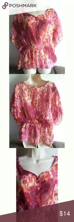 Ambiance Apparel Splash Of Color Beautiful bat wing top with elastic around the waist. 100% polyester. Splashes of pink, orange, purple and yellow. In good condition no visible signs of wear. Beautiful neck line. Size large Ambiance Apparel Tops