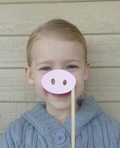 pig noses on a stick - for olivia birthday older children favors.  I made mine with felt to match the ears I made instead of paper.