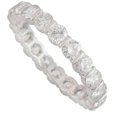 For Sale on - A beautiful Tiffany & Co. diamond set full eternity ring in platinum. The ring is tension set with 20 round brilliant cut diamonds totalling approximately Full Eternity Ring, Eternity Ring Diamond, Eternity Bands, Wedding Band Styles, Wedding Bands, Tiffany Wedding Rings, Cheap Engagement Rings, Tiffany And Co, Jewels