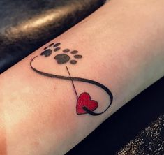 Mar 2020 - The heart is an enduring symbol of love that has lasted the test of time, and heart tattoos provide a special way to display that love. It has been used by many cultures throughout history, and its… Infinity Tattoos, Wrist Tattoos, Dog Tattoos, Cute Tattoos, Body Art Tattoos, Paw Print Tattoos, Garter Tattoos, Rosary Tattoos, Bracelet Tattoos