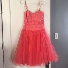 Gorgeous Morgan and Co. Coral prom/formal dress! This dress is SO cute! I wore it to a dinner theater and to homecoming and received tons of compliments. It is a lovely coral color that flatters every complexion and has stunning beadwork across the bodice.  It says it fits size 3/4 but I would say it is more of a small 0/2 size. Morgan & Co. Dresses Prom