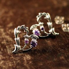 These Thistle Heart Earrings emdody the heart and soul of Scotland. Two purple thistles, the National flower of Scotland form a beauitful he...