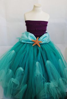 Included in price: - Floor-length tutu skirt adorned with star fish  - Purple ruffle tube top  - Star Fish headband  *Wig is NOT incuded*    This costume is completely hand made and will be processed in 3-5 business days. Please measure for fit, as NO RETURNS/ EXCHANGES ARE ACCEPTED! If you need a different size other than those listed, contact me with those measurements!    MEASURING GUIDE: SIZE 3  Chest: 23.5  Waist: 20.5  Length (from waist to floor): 23    SIZE 5 Chest: 24  Waist: 22.5…