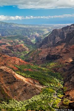 Looking down the Waimea Canyon toward the Pacific Ocean from the Pu'u Hinhina Lookout on Kaua'i. Waimea, in Hawaiian, means red. Some also call this canyon, the Grand Canyon of the Pacific, due to the way it resembles the Grand Canyon on the mainland Visit, see, travel or tour in Hawaii. Wish you could go there too? imagine yourself making USD1000 a DAY! yes, per day! visiting these places are no longer a dream. click the picture, enter ur email address, and watch the video.