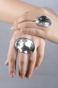 Young-Sun Song, Hug Ring & Knuckle Space, 2014, rings, sterling silver, 2 x 1 x 2.5 inches & 1.5 x 1.5 x 1.5 inches, photo: Lauren Fiasconaro