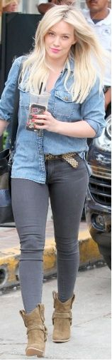 Hilary Duff wearing a denim shirt, gray jeans, and western booties