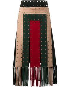 This multi-coloured Valentino studded patchwork suede skirt is an exotic showpiece from the brand's Africa-inspired SS '16 ready-to-wear collection. Flawlessly constructed in Italy, this captivating skirt has been assembled from suede and features a wrap closure, snap button fastening and four multi-coloured front panels complete with slits. Punctuated with the brand's trademark multi-coloured studs throughout and suede fringing along the hemline, coordinate yours with a black top and thong…