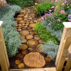 Another beautiful idea for a custom garden path using reclaimed wood. as seen on growsonyou.com