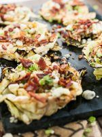 Grilled Cabbage Steaks Marinated With McCormick Grill Mates Smoky Applewood seasoning, topped with Bacon, Blue Cheese, and Green onions!