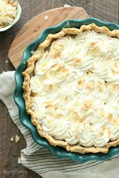 """This to-die-for Coconut Cream Pie has a dreamy homemade, sweet coconut custard filling and it's topped with plenty of whipped cream. Today my neighbor asking me if I was still """"batching it"""", and I looked at him with a confused look on my face. """"What's that mean?"""" I asked. Is your fiancé still out of …"""
