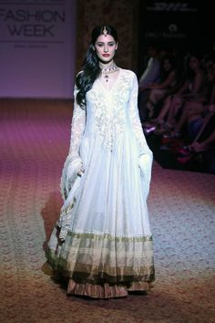 Nargis Fakhri walks the ramp for Ritu Kumar at Lakme Fashion Week Winter-Festive 2013; eStore http://www.ritukumar.com/ritukumar/