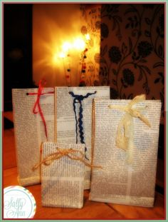Book Page Gift Bags. Fairly simply to construct with two pages, glue, and a small piece of cardboard.