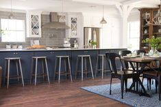 """(Fixer Upper) This is a modern twist on the old school """"galley"""" style kitchen a lot of us grew up with. By elongating the kitchen, adding the oversized island and the columns, the Phipps family will have more than enough prep space and also bar seating. #kitchenislands"""