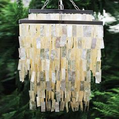 Edgy and elegant, this chandelier glows with natural charm. Layers of glimmering oyster shell make a delicate, iridescent contrast to the squared-off iron base. This chandelier is an excellent choice for modern and romantic mood lighting.