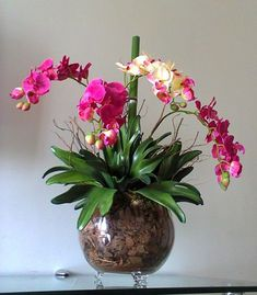 How To Keep Orchids Alive And Looking Gorgeous Orchid Flower Arrangements, Orchid Planters, Orchids Garden, Exotic Flowers, Faux Flowers, Beautiful Flowers, House Plants Decor, Plant Decor, Orquideas Cymbidium