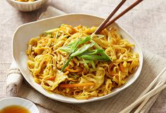 Crispy fried chicken pieces tossed into spicy curried noodles