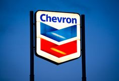 An illuminated Chevron sign. Chevron Signs, Product Photography, Chicago Cubs Logo, Team Logo, Editorial, Symbols, Logos, Art, Art Background