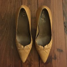 Anthropologie Yellow Pointed Toe Heels Cute heels that I have barely if ever worn Anthropologie Shoes Heels