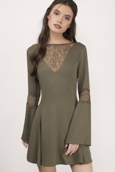 Designed by Tobi. The Flirt Around Lace Dress features a plunging mesh front neckline and back key hole. With slight bell shaped sleeves and a figure  - Fast & Free Shipping For Orders over $50 - Free Returns within 30 days!