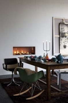 love the fireplace and green rocking chair