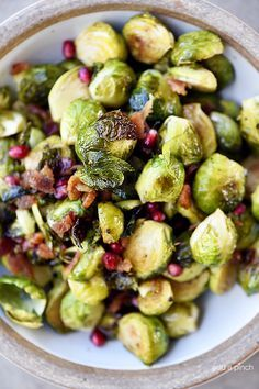 Roasted Brussels Sprouts with Pomegranate and Bacon by addapinch #Brussel_Sprouts #Bacon #Pomegranate