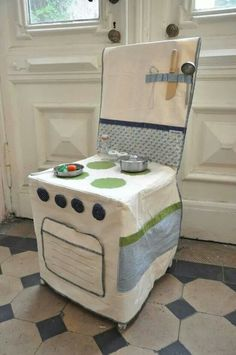 What a clever idea--- a chair cover converted to a child's play stove! WOW What a great idea !!!!!!!!